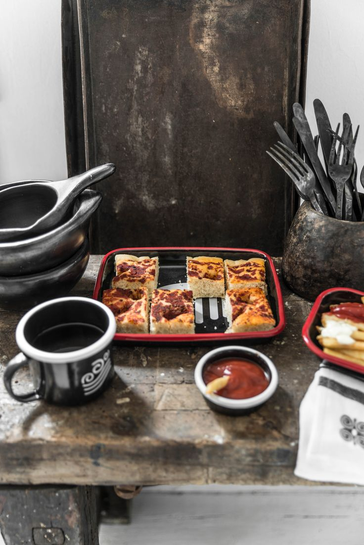 Mesele enamelware collection for christmas.Black and red enamel tray ,black enamel mug ,black and red rectangular plate and black small bowl. Photo and styling by Paulina Arcklin
