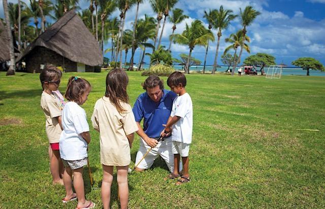 Kids Playing Mini Golf - La Pirogue Resorts & Spa, Mauritius