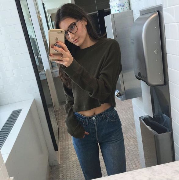 cropped sweatshirt + hw jeans + glasses + boots