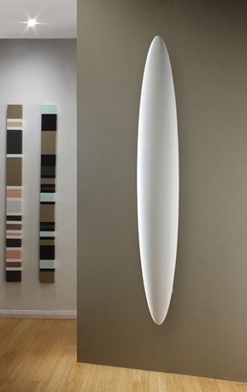 Blade Radiator by The Radiator Company. Made from aluminium, this subtle surf board design gives the Blade universal appeal.