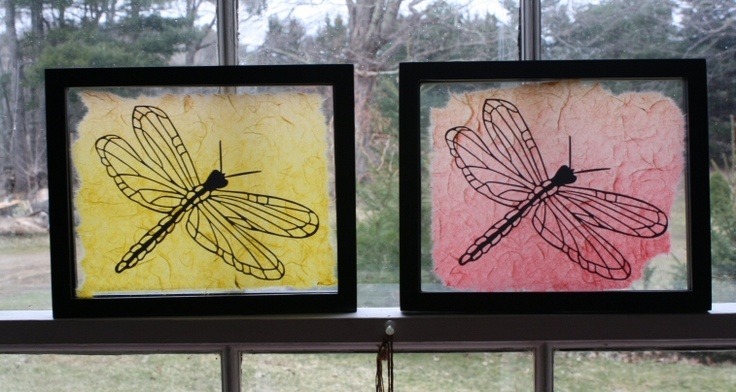 Dragonfly paper cuts mounted on deckled Mulberry paper in clear frames to allow sunlight to pass through