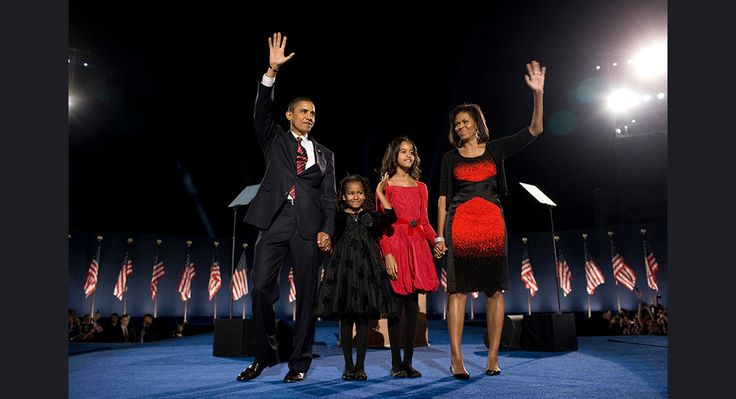 Obama stands with his wife Michelle Obama, right, and two daughters, Malia and Sasha, as they wave to the crowd at the election night rally in Chicago on Nov. 4, 2008.