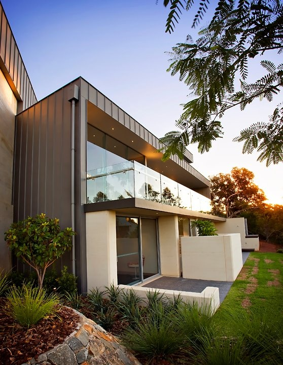 zinc cladding and rammed earth - how well do they work together?!