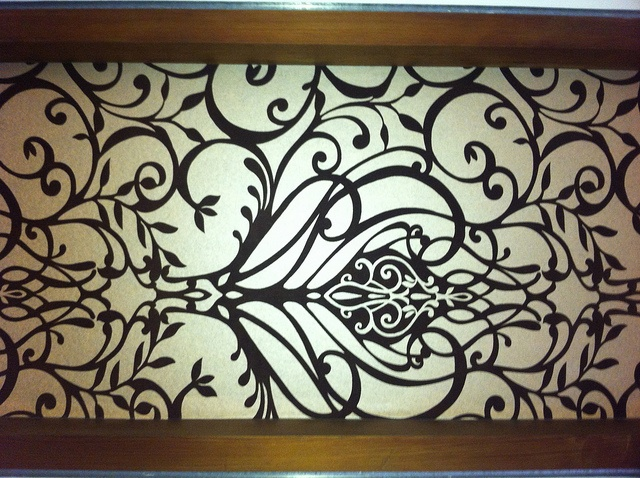 Damask Wallpaper over a glass window