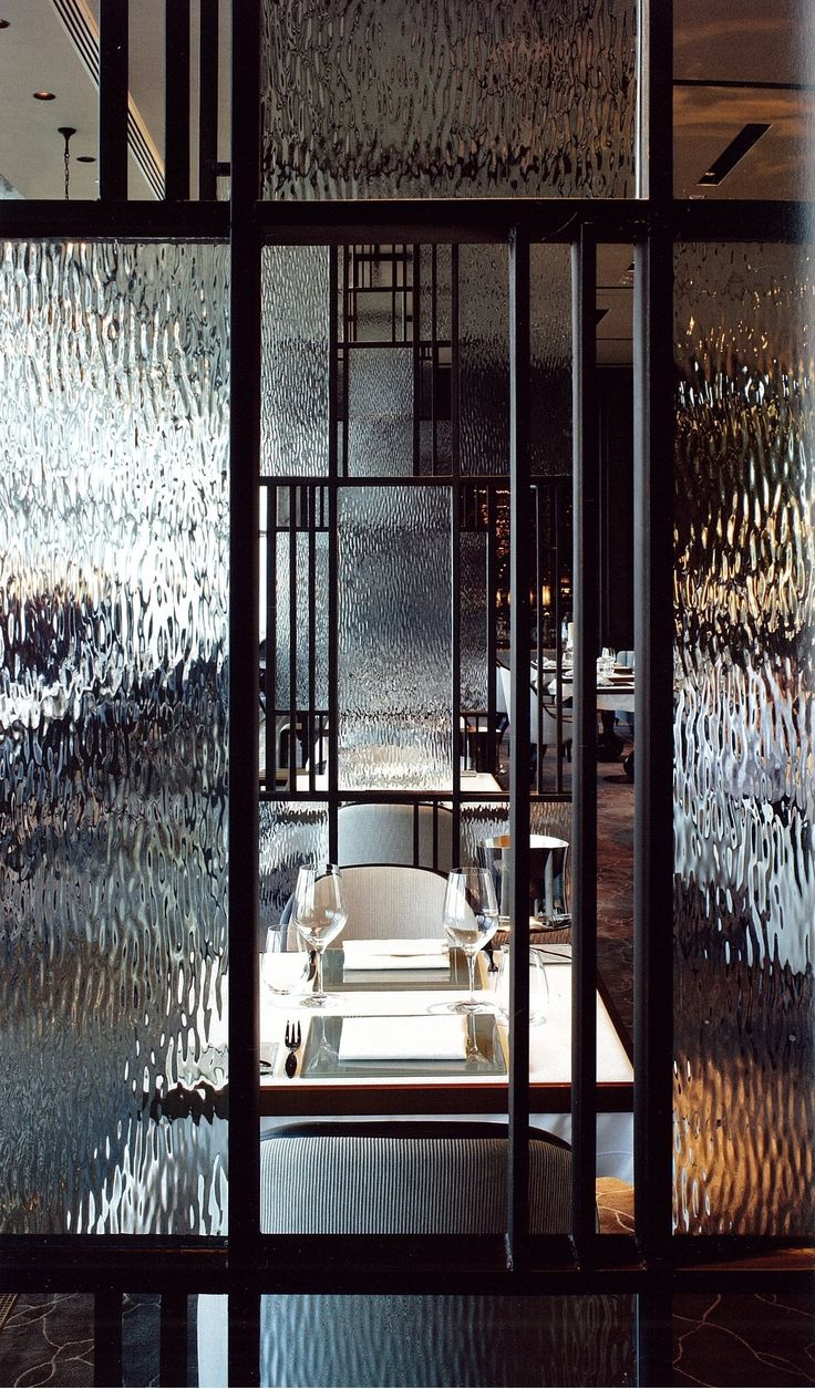 The French Window, by AB Concept | Hong Kong - This comes close to resembling my idea for the entrance area for SUStAIN. A half wall (approx. 1m high) with a thin steel frame interior window above separating entrance and restaurant. Some panes of clear glass to offer glimpses of diners, others patterned glass to obscure view. I think the patterned glass would then catch the light and give a lovely intimate sparkle as diners enter/ exit, especially as it is next to a large factory window.