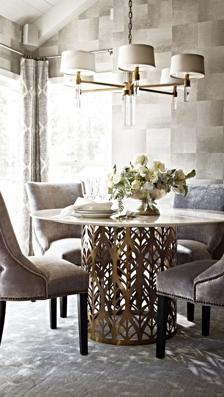 Lined up like a row of cypress trees in a Van Gogh painting, the laser-cut standing-leaf pattern decorating the sides of the Downing Dining Table is crafted from brass-plated steel sheeting. | Frontgate Interiors