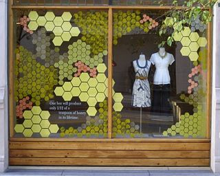 Honey bee inspired window display at Anthropologie.