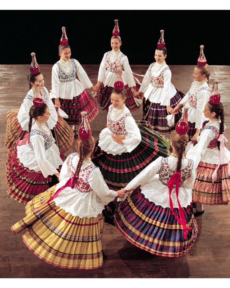 Hungarian dancers balance bottles on their heads!                                                                                                                                                      More