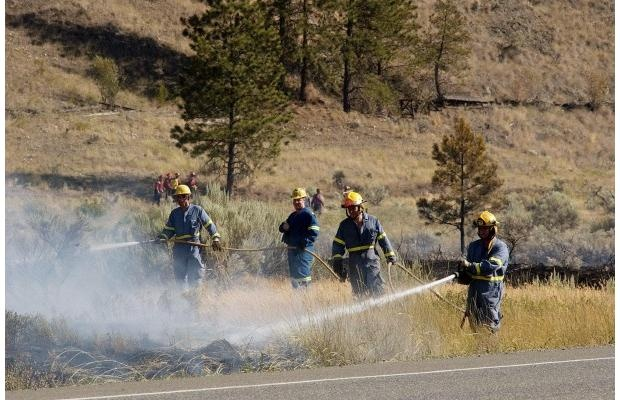 Firefighters battle a blaze on Mount Paul on the northern edge of Kamloops in this file photo. In 2012, the no. of fires in the area is consistent with historical averages, but the amount of area that is being burned has risen dramatically.