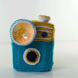 I love this. Oh my word. So cool. She knitted this put a styrofoam block inside with a little battery light attachment in the flash and button. fun creative ingenuity .
