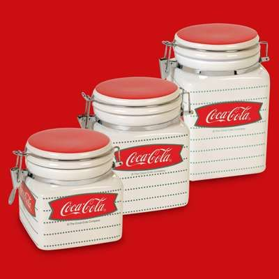 Coke canisters    Sometimes you don't want things to look all neat and pretty. For some, they want to organize their stuff in kitchy containers. Like these Coke canisters. What do you think?