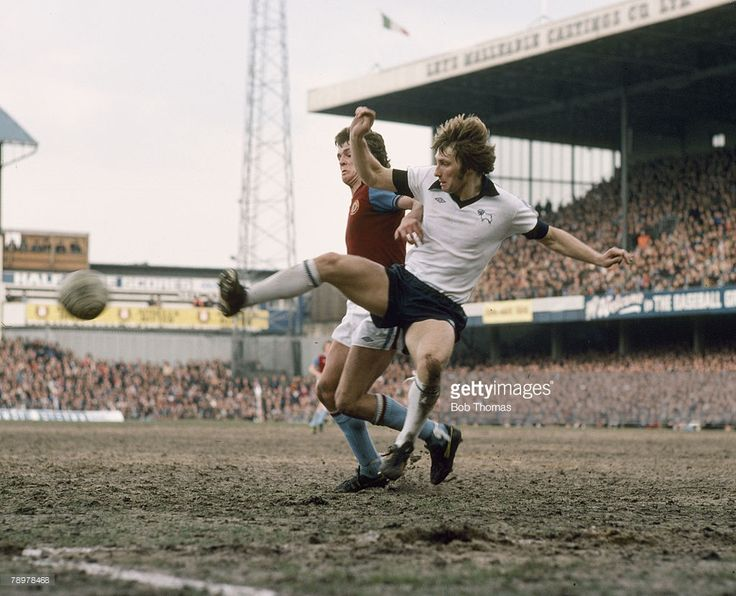9th April 1977. Derby County defender Colin Todd clears from Aston Villa's John Deehan at Baseball Ground.