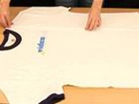 T-shirt folding FAST! Get a t-shirt ready. Watch the video. Then practice it following the video. THEN keep doing it on ALL those t-shirts you have stacked up waiting to be folded!