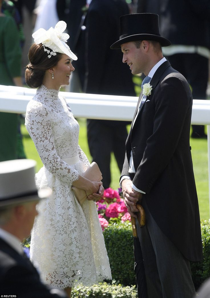 The Duchess of Cambridge and Prince William steal a quite moment for a chat after the carr...