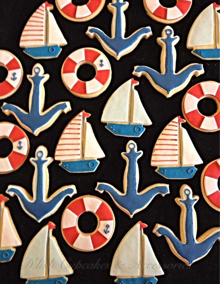 Nautical cookies, sail boat cookies, anchor cookies, life buoy cookies. Nautical cookie cutters available at www.dlishcookies.com