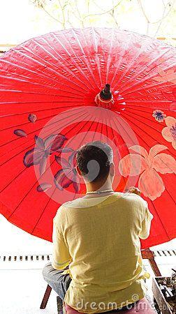 Thai Artist painting on umbrella at Bor Sang, Chiang Mai, Thailand