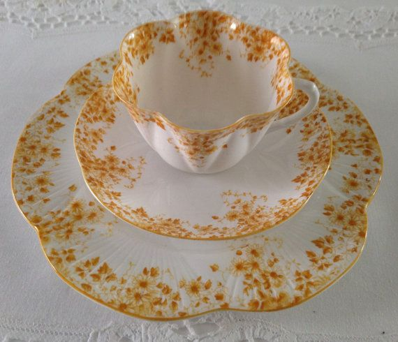 Wonderful vintage Shelley dainty yellow bone china tea cup, saucer and luncheon/dessert plate, made in England. they are in good condition, no chips, cracks or crazing, there are some light utensil marks on the plate. Please Note: The items I sell are not new, they are