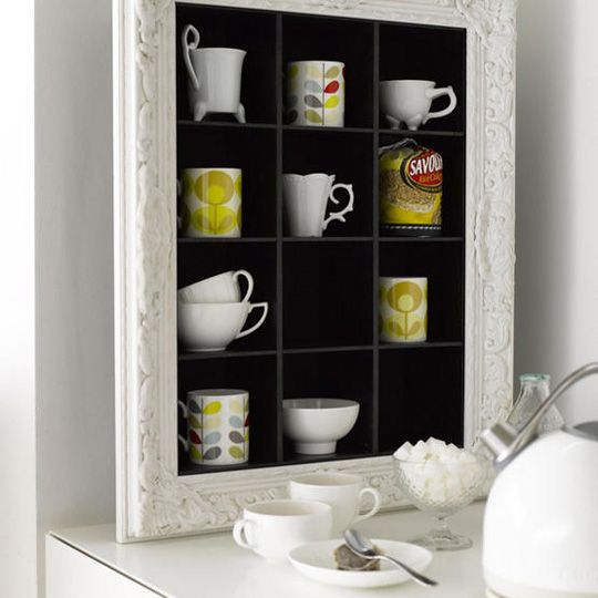 This is actually a CD storage unit with a frame attached! With all the mugs we will all have, it might be best to find a way to make them art in the kitchen rather than take up storage space.