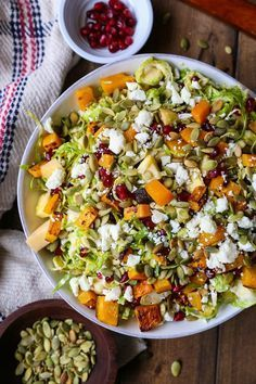 Shaved Brussel Sprout Salad with Roasted Butternut Squash, Pomegranate Seeds, Pumpkin Seeds, Feta, and Citrusy Maple Cinnamon Dressing | http://TheRoastedRoot.net