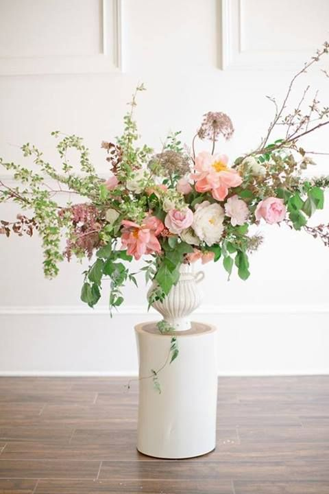 Beautiful free-form floral arrangement in a classic white urn. #wedding #flowers