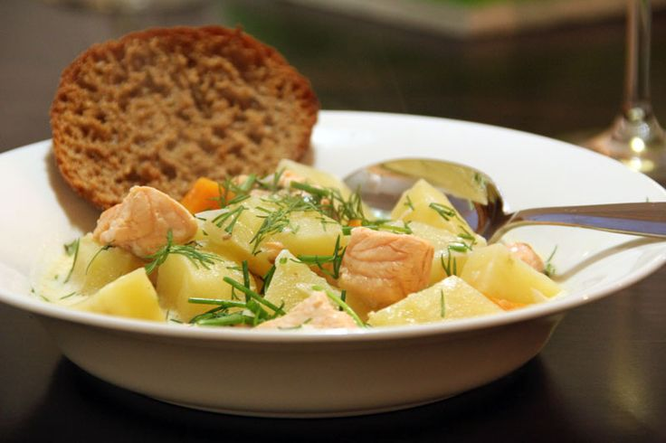 Soft and creamy salmon soup with rye bread. Yum Yum ! Finland