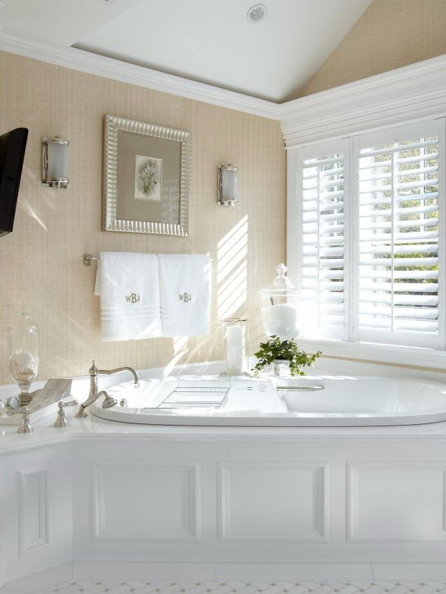 Photo Of This luxurious beach house master bathroom embraces the home us natural surroundings adding plenty of natural