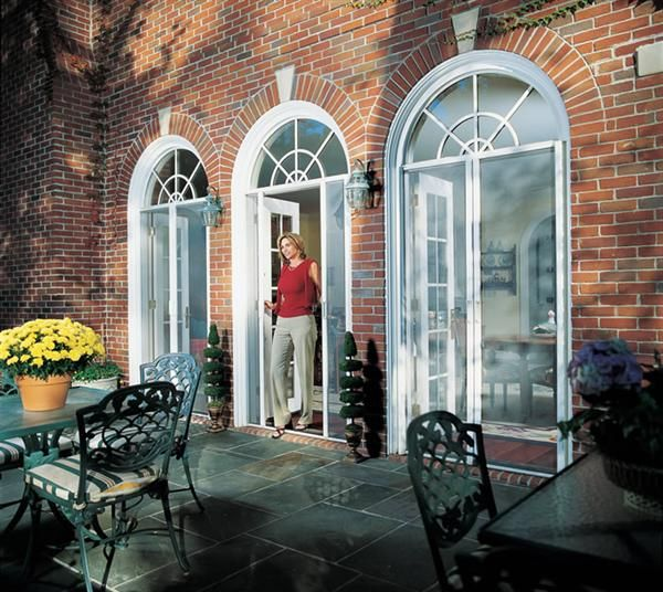 Retractable screen door housings are constructed of lightweight aluminum to protect the screen cloth when not in use and can be made to fit almost any household doorway