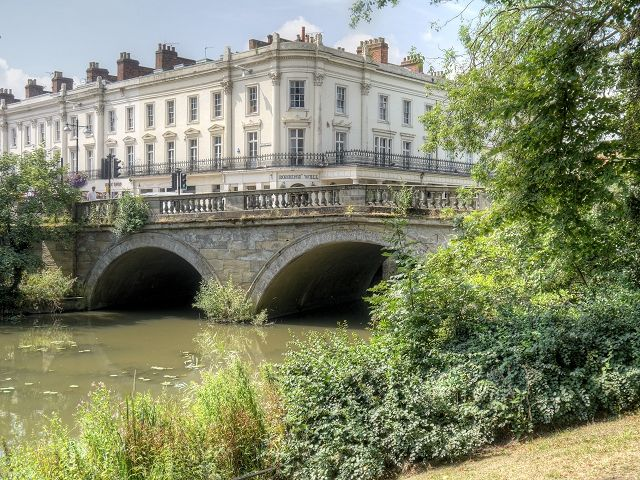 """Victoria Bridge over the River Leam. The River Leam (pronounced Lem and sometimes spelled """"Leame"""") is a river which flows through rural Warwickshire, including the town of Royal Leamington Spa. Victoria Bridge was built 1807 10 and widened 1839 40. Grade II listed."""
