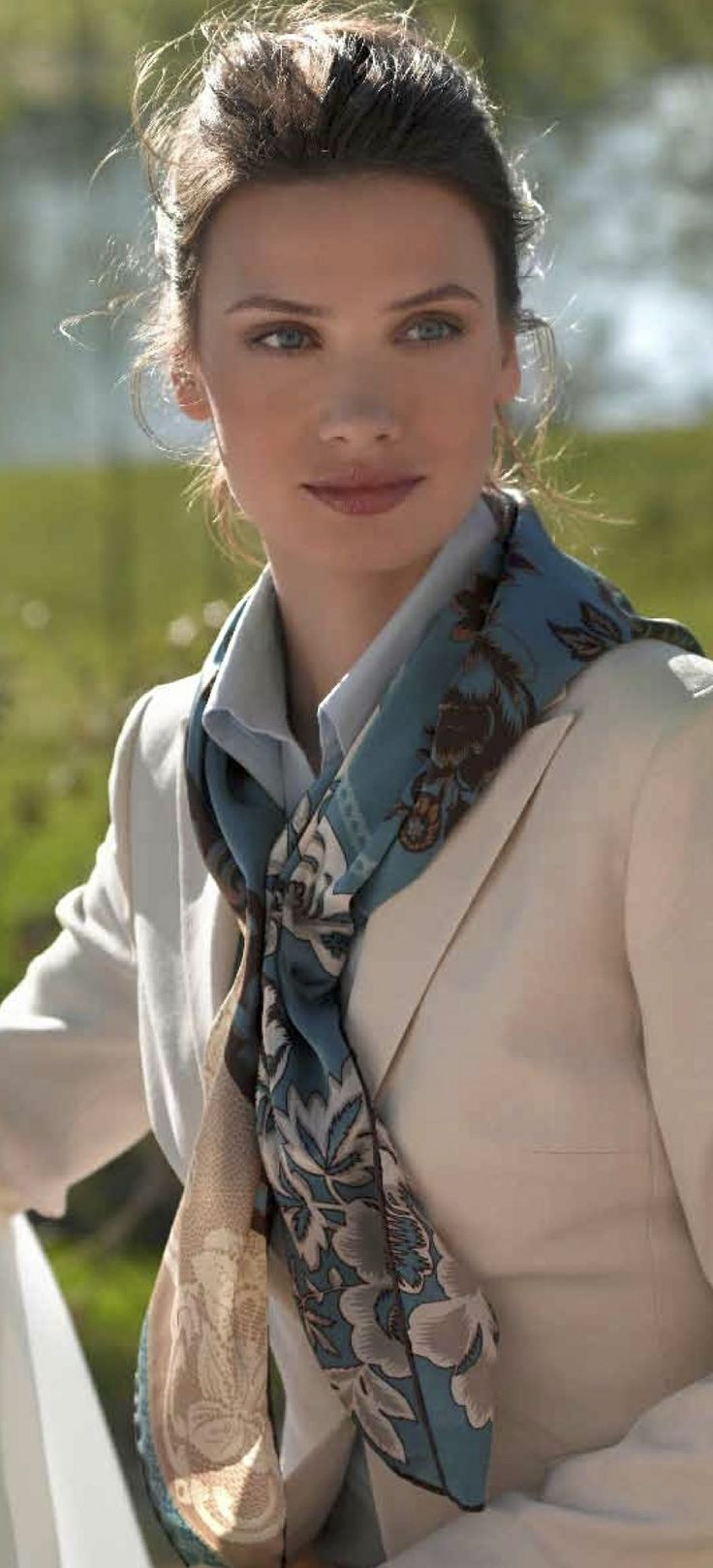 Love how she is wearing this scarf.