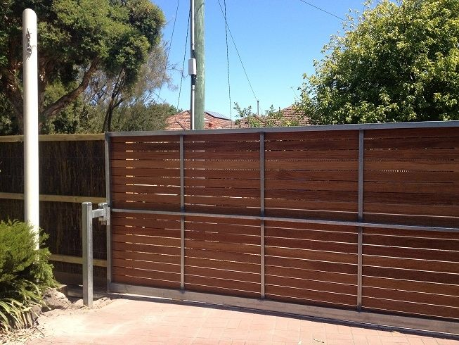 Horizontal merbau sliding driveway steel frame gate