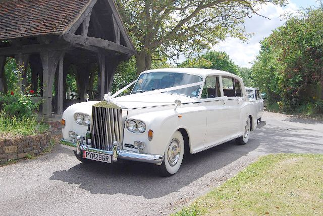 Do you fancy a stunning wedding car supplied by Park Ward Carriage Company? Bubbly for the Bride and Groom :-)  Mention ESSEX VENUES and receive an extra; 'additional 4 glasses for Mum's and Dad's'  Rolls-Royce Phantom VI Landaulette Daimler DS420 Landaulette 6 seater for your wedding in Essex or Hertfordshire. Both Cars are Quarter Convertible. Tel: 0208 5242051 or 07973 740 889