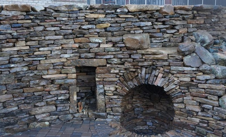 Dry stone wall with fire pit grotto