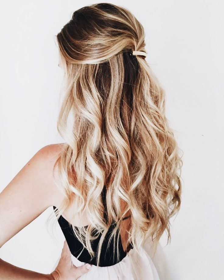 Great style for long waves—a great barrette pulled back and secured under the crown shows off highlights and shows off a facial, spray tan, or large hoop earrings.