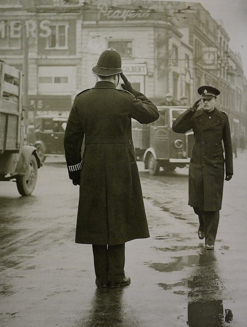 A police constable on point duty saluting his Section Inspector c.1948, London.