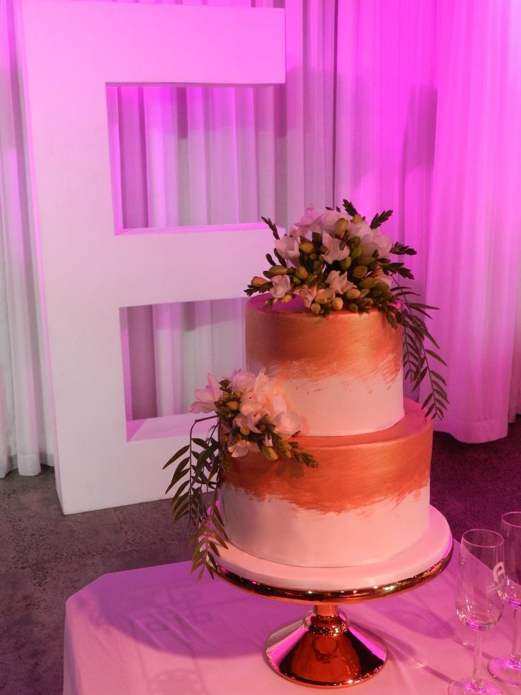 This cake was stunning with its gold and fresh flowers on top.