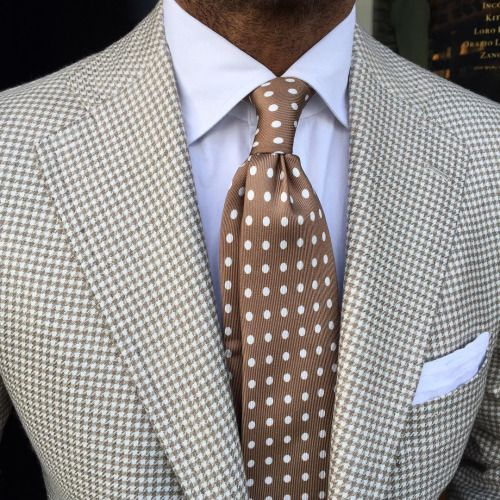 Cream houndstooth jacket, white shirt, being tie with white polka dots