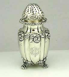 Howard and Co Sterling Silver Sugar Shaker. An antique sterling silver sugar shaker by Howard and Co of New York dated 1895. Monogrammed on the side with a script monogram. Cast applied paw feet. The lid pulls off. Hand chased decoration