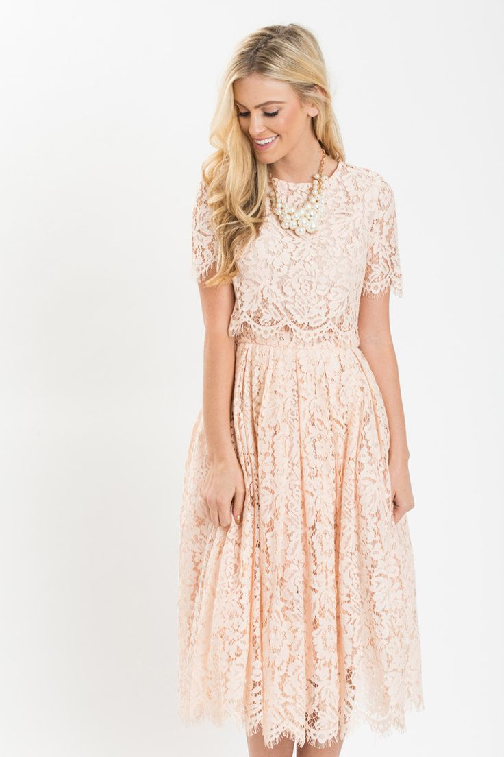 We finally found the dress of our dreams! This short sleeve blush midi dress is flattering, romantic, and just plain gorgeous! The mesh midsection makes this look like a crop top & midi skirt matching