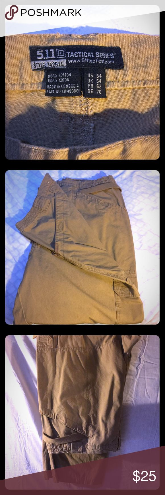 """5.11 Tactical Pants men's size 54x30 5.11 Tactical Pants. EUC no rips stains or tears. Very rarely worn. Smoke free home. Color is """"coyote"""" darker khaki/tan. 🚫No trades. Reasonable offers welcome.                                                              8.5 oz. cotton canvas fabric Action waistband Double- reinforced seat and knees (kneepad ready) Bartacking at major seams and stress points Seven pockets, including strap- and- slash pockets Hip- mounted D- ring YKK® zippers Prym® snaps…"""
