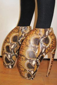 Lobster Claw Shoes - Alexander McQueen's 12inch platforms, named the armadillos.