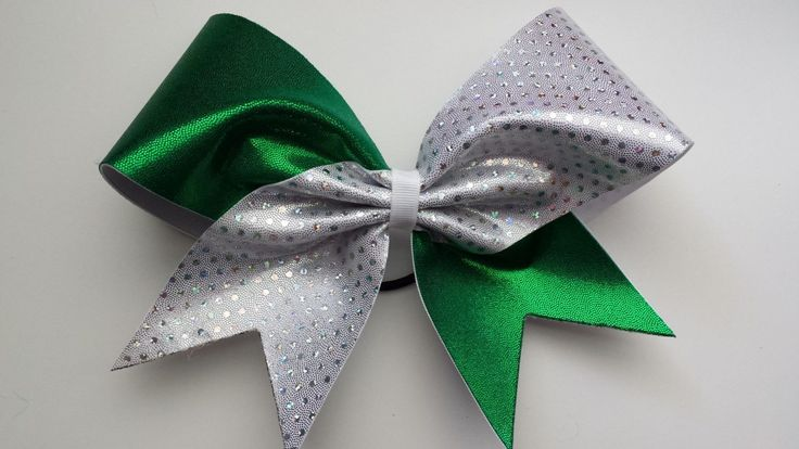 Green and white sparkly cheer bow.