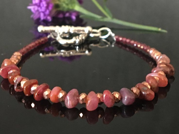 A personal favourite from my Etsy shop https://www.etsy.com/no-en/listing/539552725/lady-in-red-ruby-bracelet-july