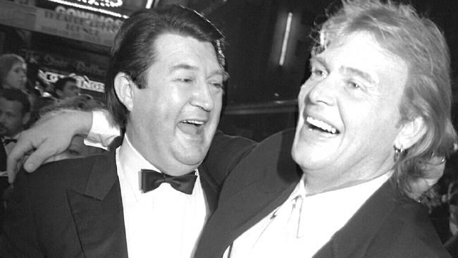 Derryn Hinch and John Farnham back in 1994. Hinch starred in the video with Jacki Weaver.