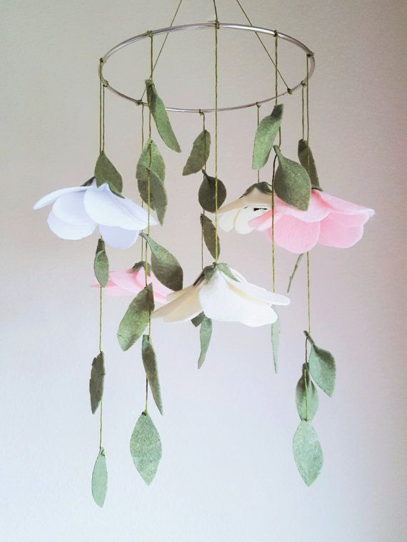 $55 Original mobile includes 25 hanging leaves and 5 anemone flowers in dusty pink, cream, and white  - Each flower and leaf is made of hand-cut felt and hung with premium olive green embroidery thread from an 8 inch steel ring  - The mobile includes a 1 inch metal ring by which you can hang the mobile simply from a ceiling hook or other safe hook.   == APPROX. MEASUREMENTS ==  Steel ring: 8 (20cm)...