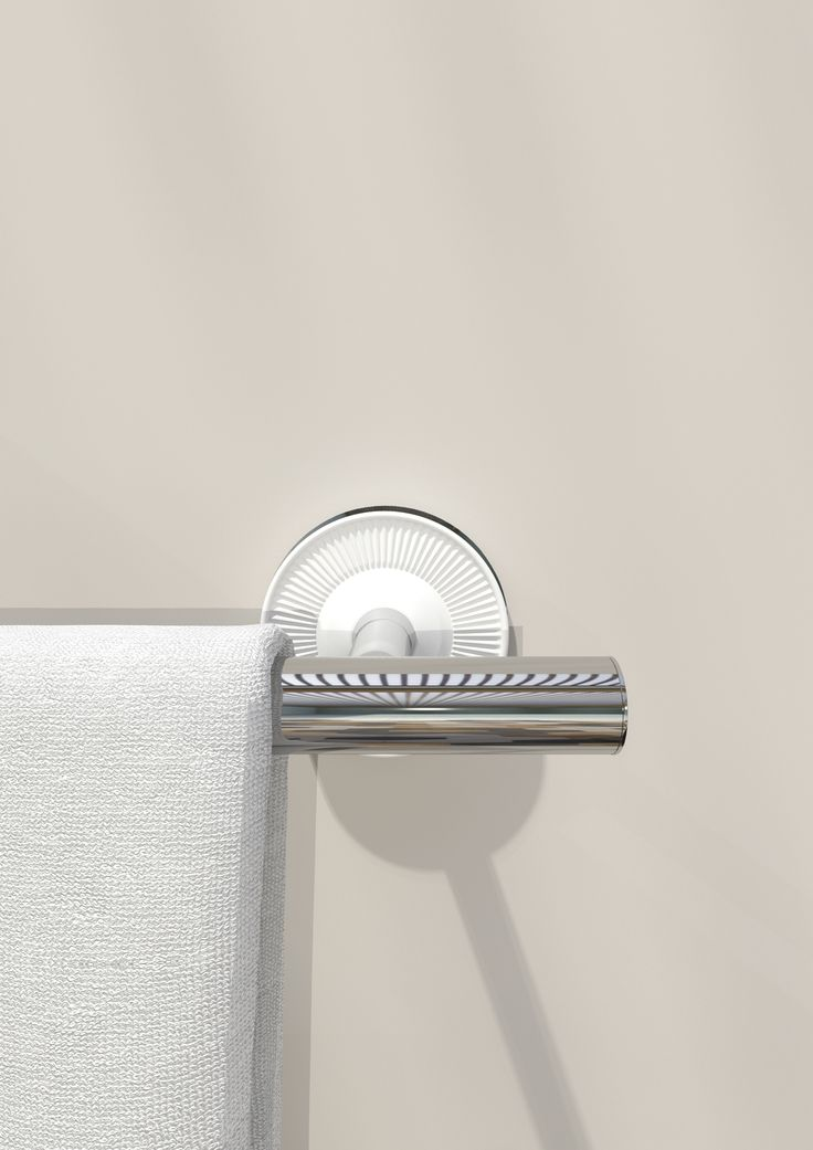 A #porcelain #rosette is assembled to the metal bar giving shape to an elegant #towelrack. #Equilibrium collection. Designed by #edwardvanvlietofficial by #pomdorbathworld and #official_rosenthal.