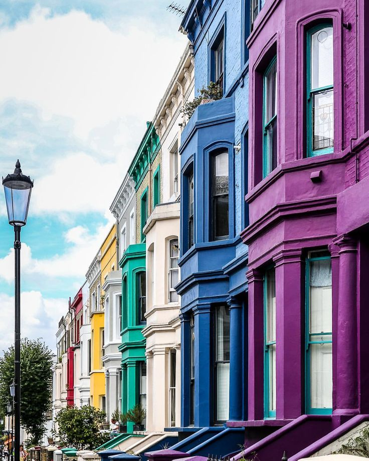A Row Of Colorful Houses In Notting Hill, London. This