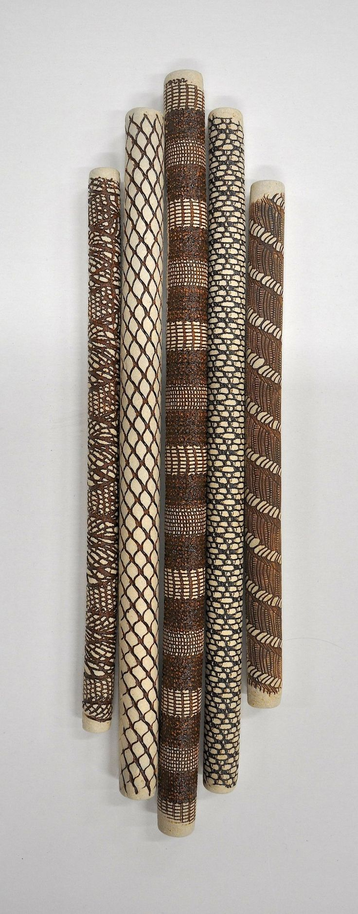 Five Wall Pieces - Light by Kelly Jean Ohl. Grouping of five individual ceramic wall sticks. Each individual piece is hand carved and hand painted. Detailed instructions are included to assist with installation. Please note that this item ships unassembled.