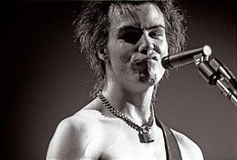 This is the guitarist, Sid Vicious of the Sex Pistols. And this is the musician Banksy was painting in his street art. http://en.wikipedia.org/wiki/Sid_Vicious