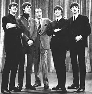 The whole family sat around the black & white television and watched history when the Beatles performed on the Ed Sullivan show!