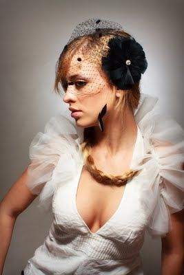 With all of that Black you will need a veil! - The veil is designed by Anne Michelle Heirlooms.  -  black birdcage veil with feather fascinator
